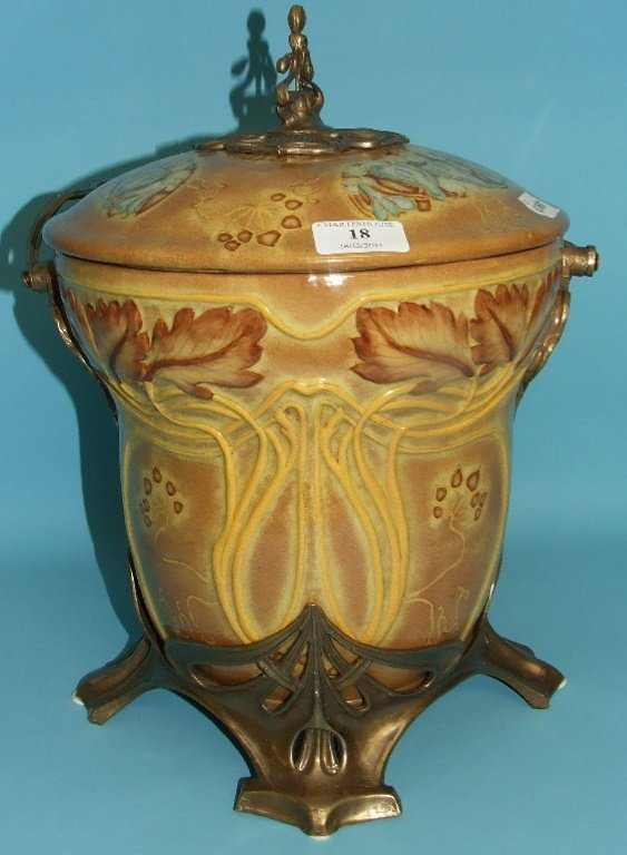 An Art Nouveau style pottery ice bucket, with metal