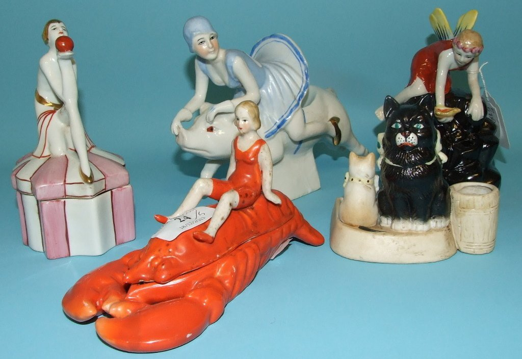 A porcelain hat pin stand, applied a fairy, and other