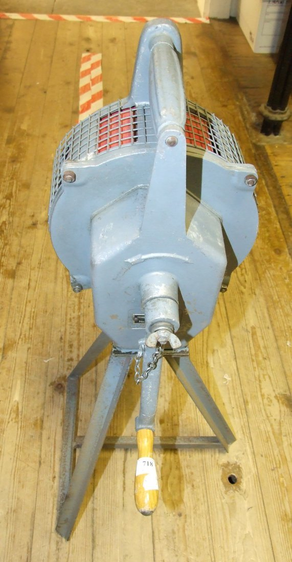 A Carter hand cranked air raid siren, on a steel base,