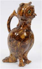 A slipware owl jug, with green eyes, possibly