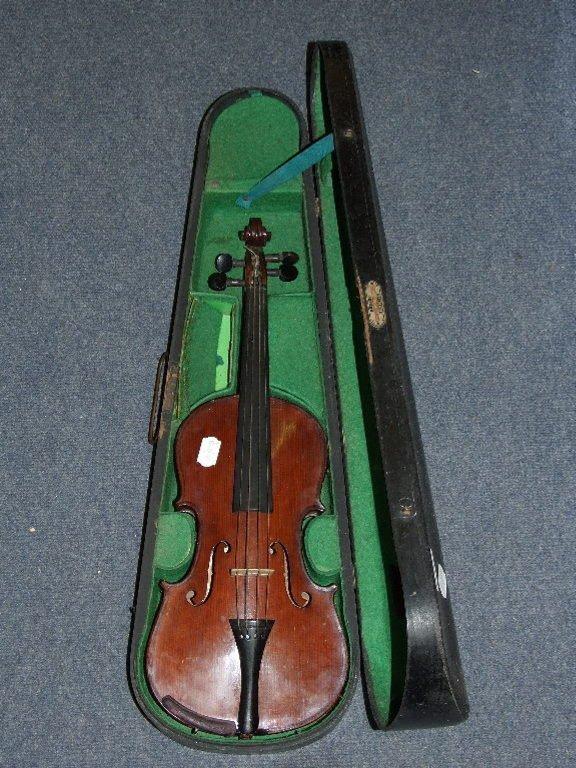 A violin, bears label Maidstone School Orchestra