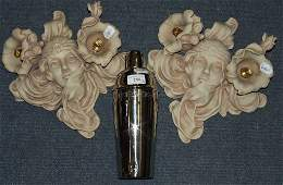 A pair of Art Nouveau style composition wall lights