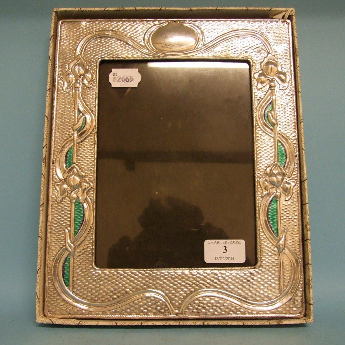An Art Nouveau style picture frame, 24 cm wide
