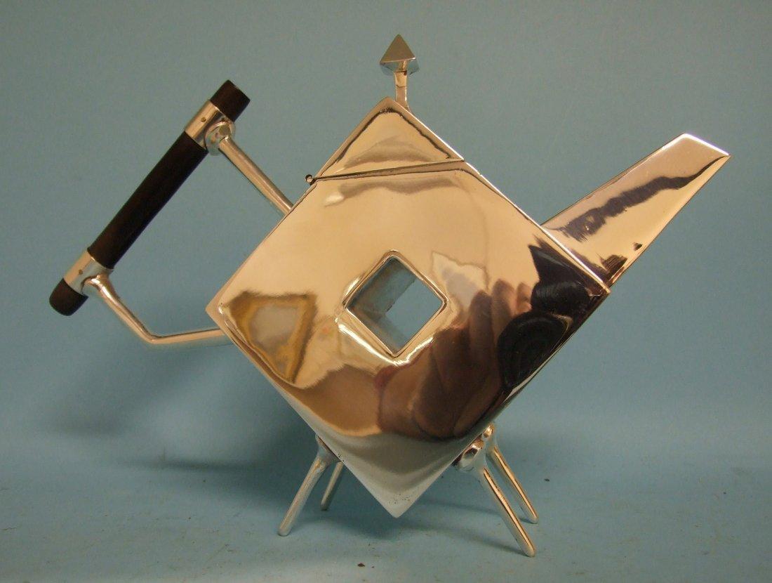 A Christopher Dresser style teapot, 26 cm wide