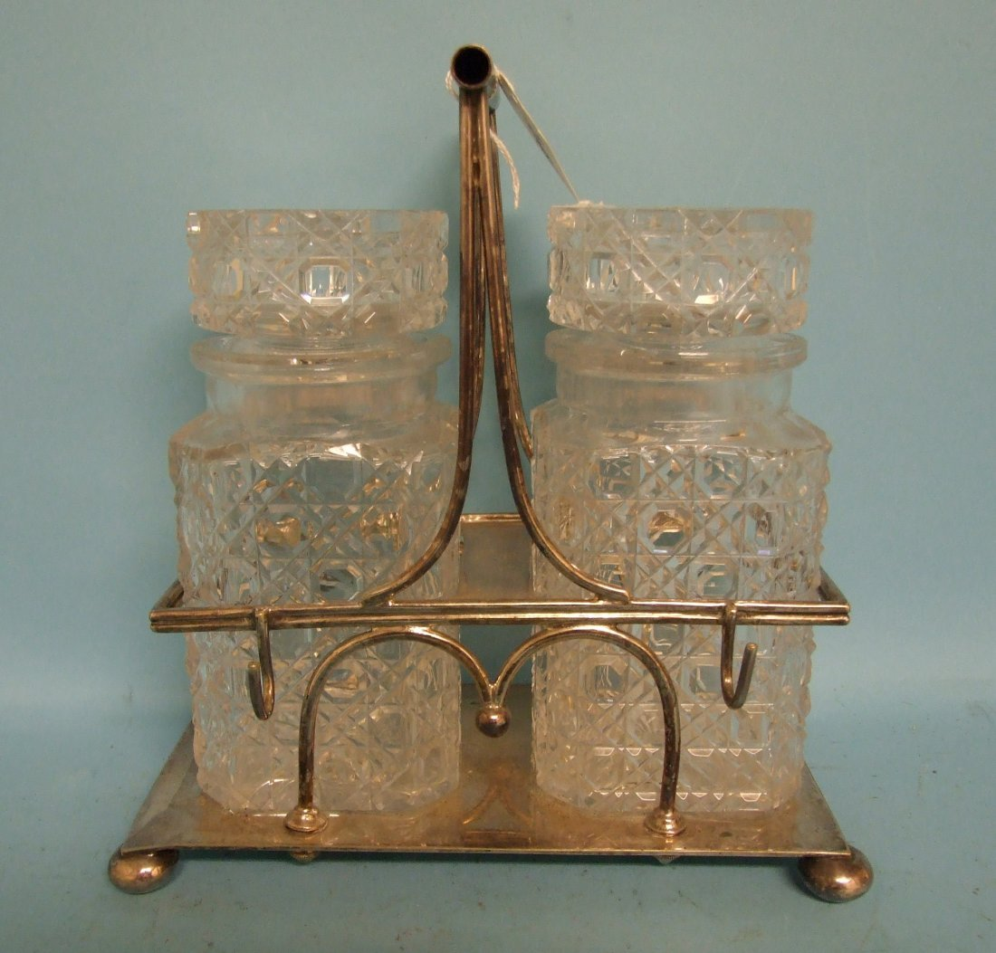 A Hukin & Heath style silver plated bottle stand