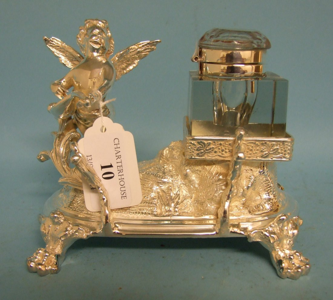 A silver plated inkwell, in the form of an angel
