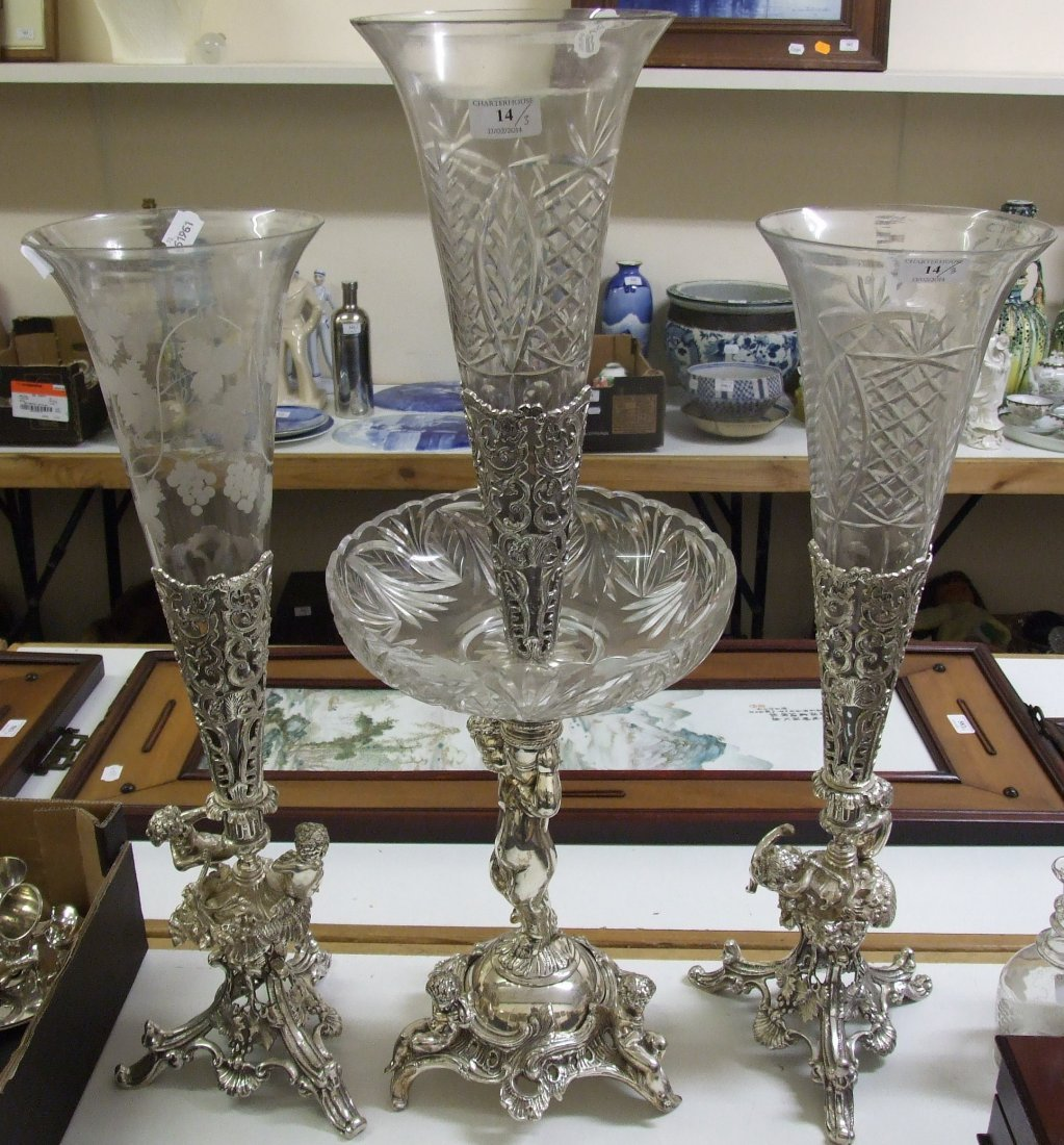 A glass and silver plated garniture of vases, with