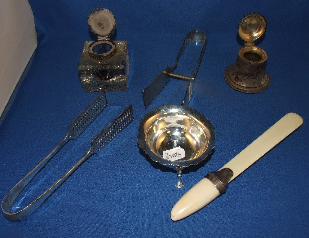 A silver cake server, Sheffield 1928, another similar,