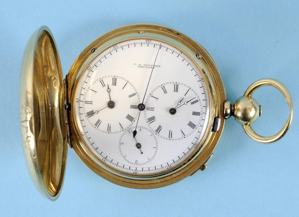 An 18ct gold hunter chronograph pocket watch, the white
