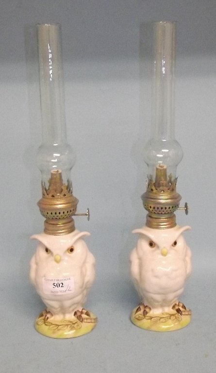 A pair of lamps, in the form of owls, 38 cm high