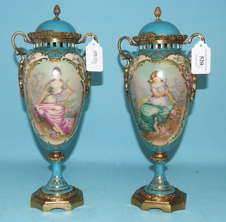 A pair of vases, with gilt decoration, decorated young