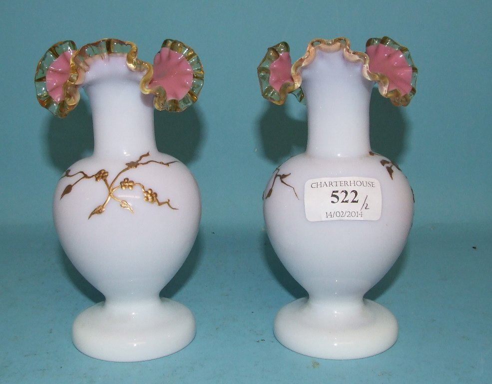 A pair of opaque glass vases, decorated flowers and