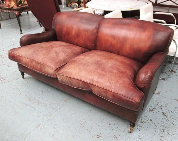 GEORGE SMITH SOFA, Howard style, in brown leather on
