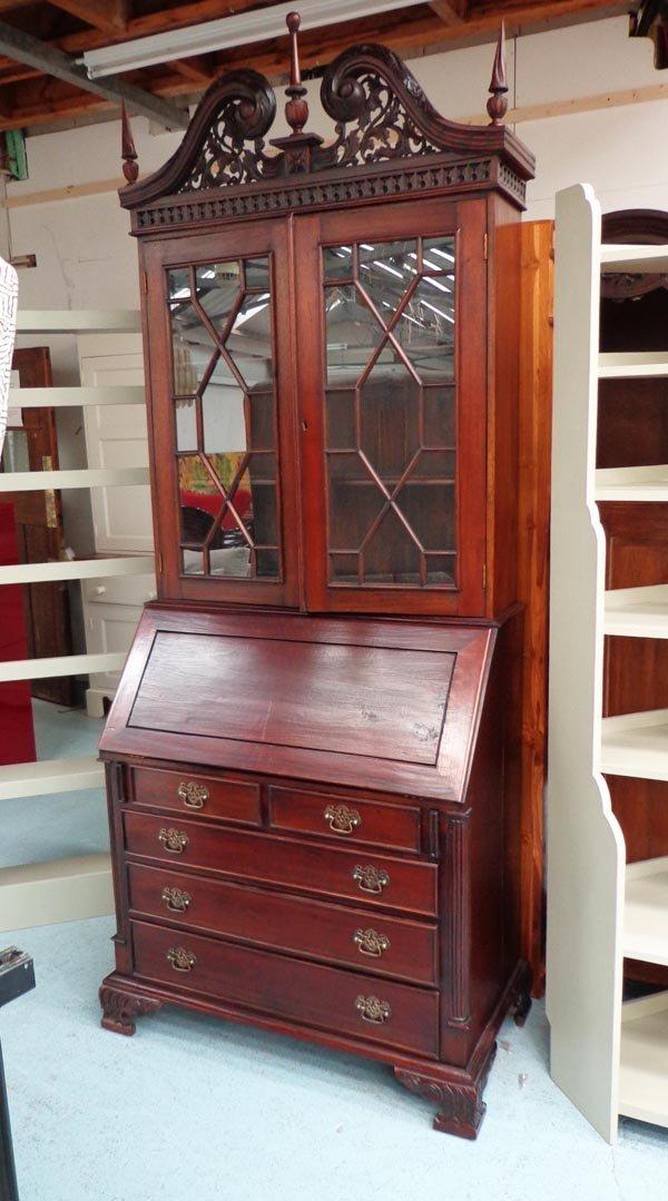 BUREAU BOOKCASE, mahogany with a swan neck pediment
