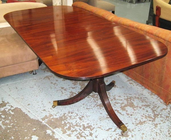 DINING TABLE, mahogany in a Regency style on two tripod