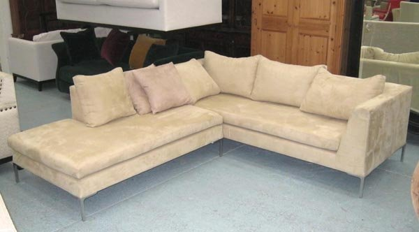 CORNER SOFA, in a beige suede with detachable chaise