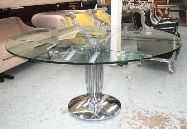 DINING TABLE, having a circular glass top and a chrome