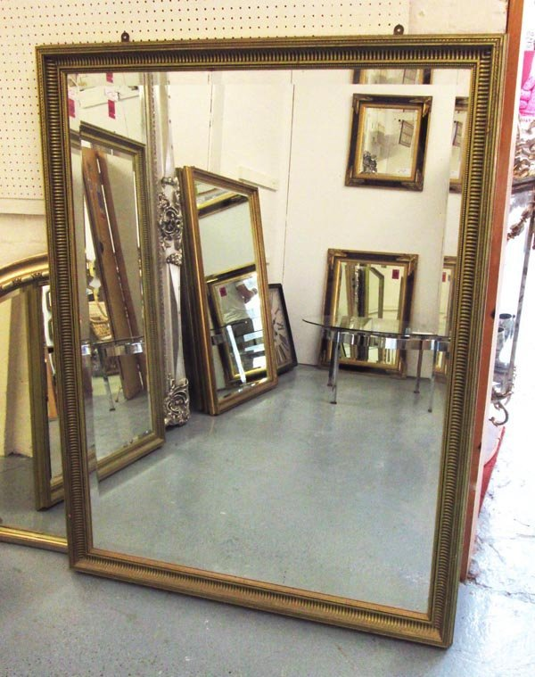 MIRROR, bevelled, with gilded frame, 131cm H x 100cm.