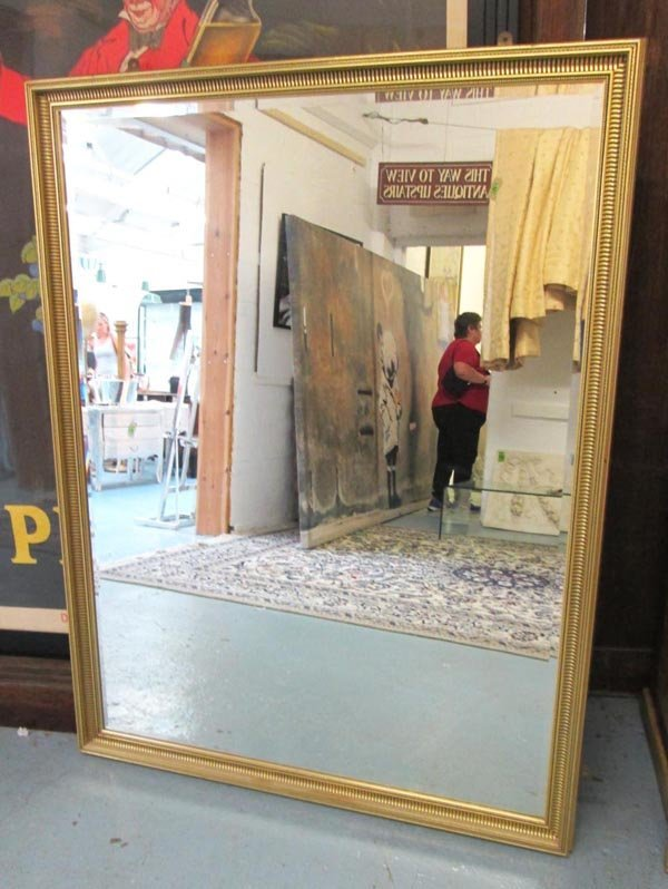 MIRROR, bevelled, with gilded frame, 150cm H x 116cm.