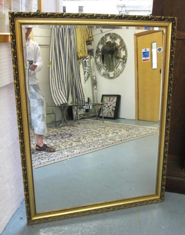 MIRROR, bevelled, in a gilded frame, 132cm H x 100cm.