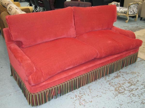SOFA, two seater, Howard style in red upholstery with a