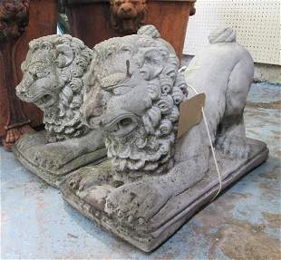 LION STATUES, a pair, in reconstituted stone, 57cm L.