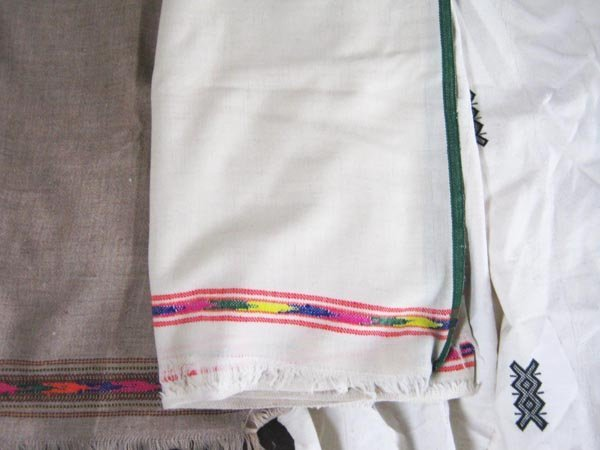 AFRICAN THROWS, two similar, with multicoloured borders