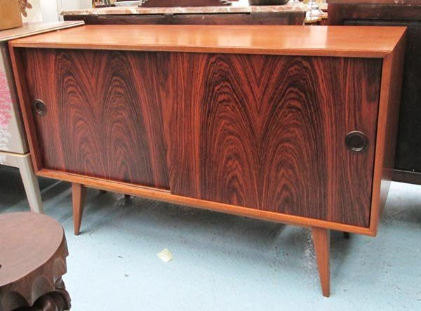 SIDEBOARD, 1960's, with sliding rosewood doors on