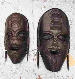 AFRICAN MASKS, two, hand carved, largest 57cm H. (2)