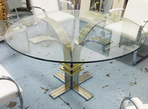 DINING TABLE, 1970's, with a circular glass top on