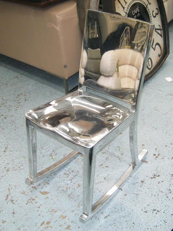 HUDSON CHAIR, polished aluminium designed by Philippe
