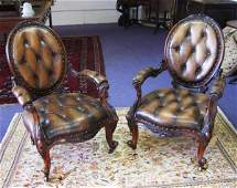 LIBRARY ARMCHAIRS, a pair, mid Victorian walnut