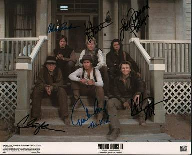 AN original 11x14 lobby card from the film signed by