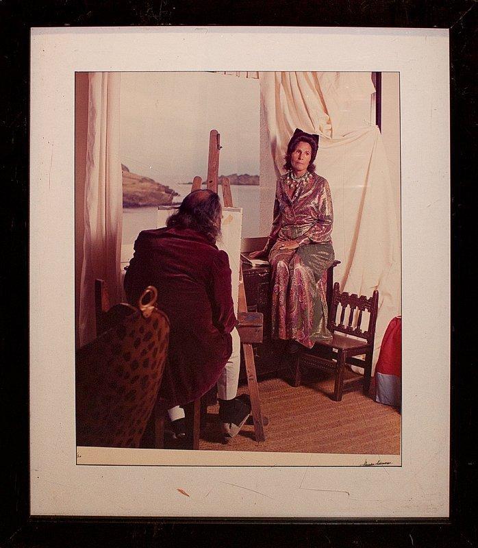 Photograph of Salvador Dali painting his wife Gala