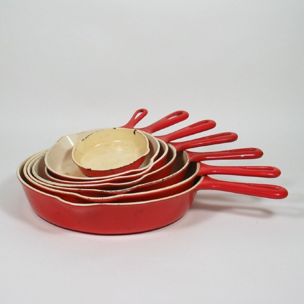 4006: Seven Griswold Skillets in Flamingo Red