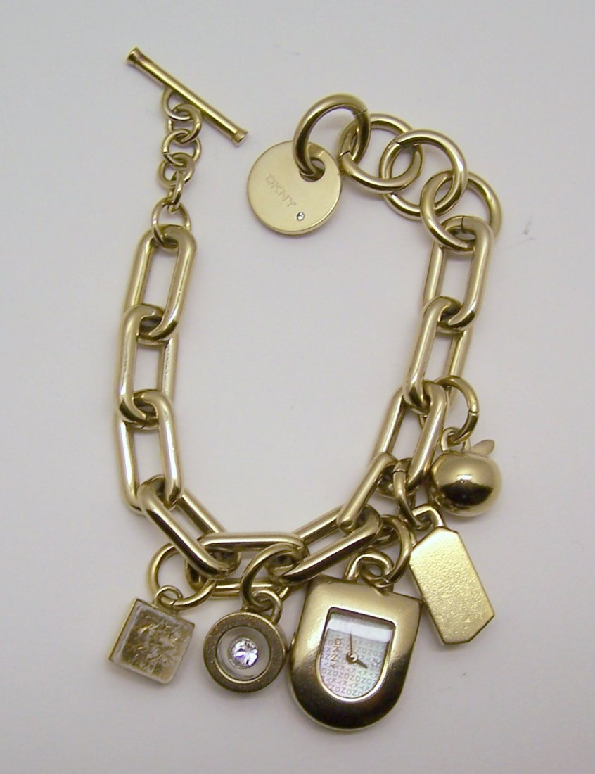 DKNY gold tone charm bracelet watch