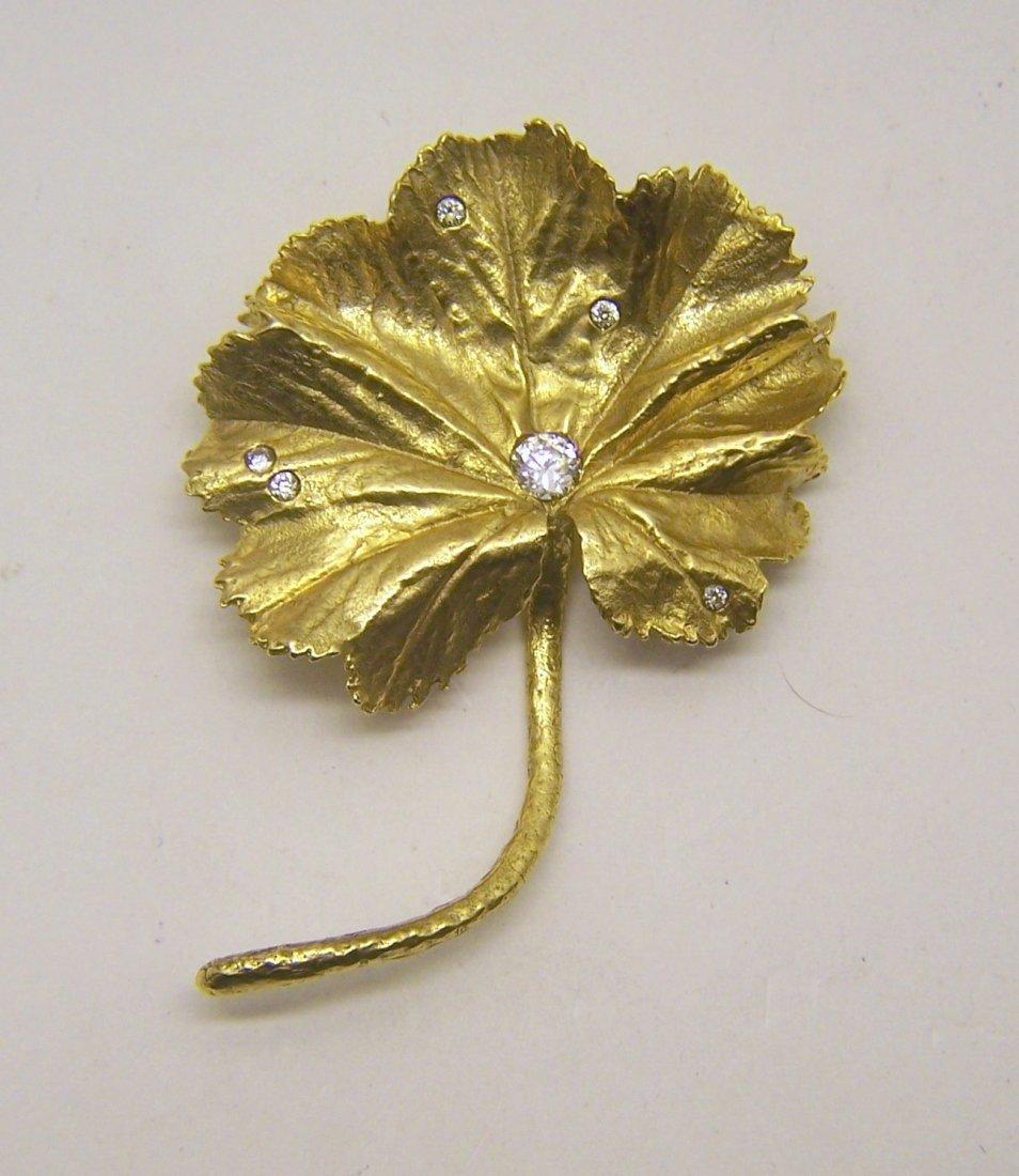 MMA gold tone CZ flower brooch pin