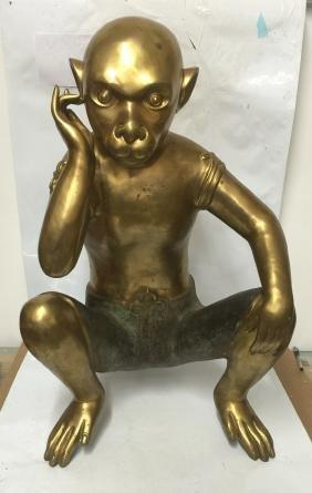 Large gilt bronze monkey.