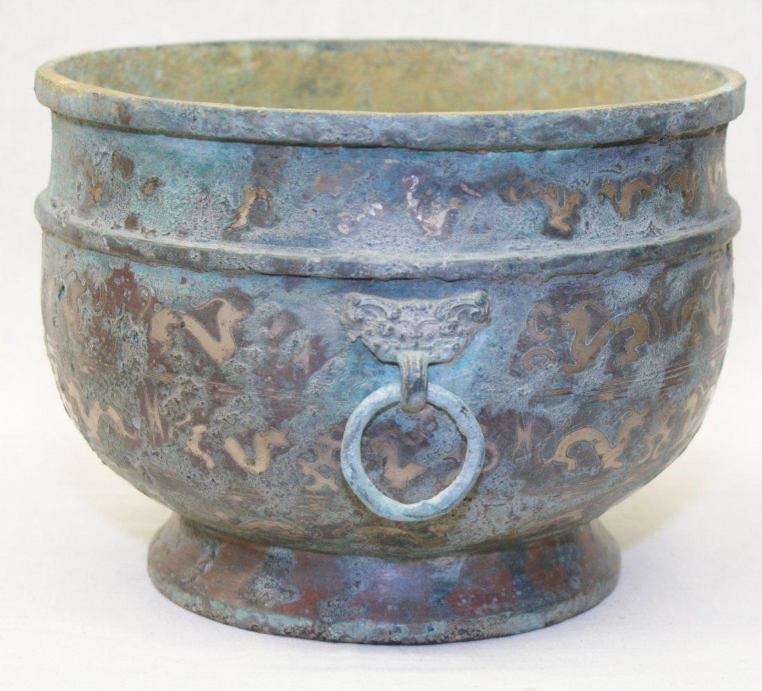 Silver inlaid bronze vessel.  Han Period.