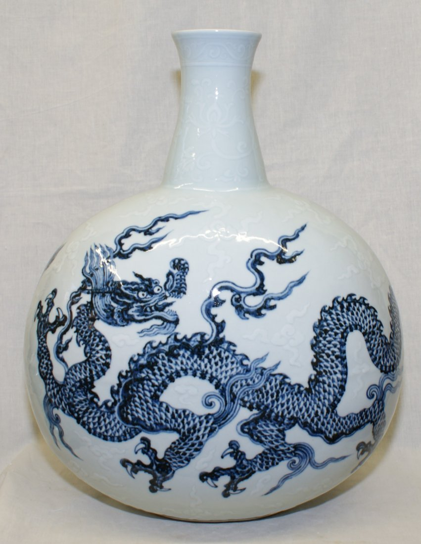 Blue and white flask painting of dragons.  Early Ming