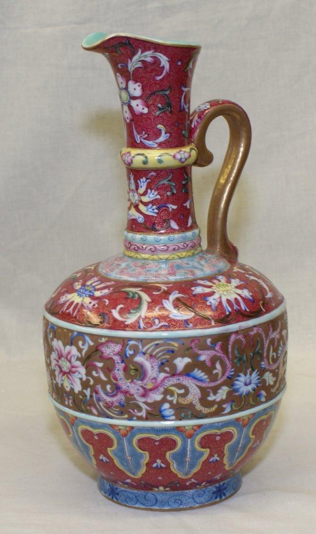 Crimson red famille rose ewer-shape vase. Qianlong Mark