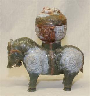 Archaic jade cow zun. Han Period.