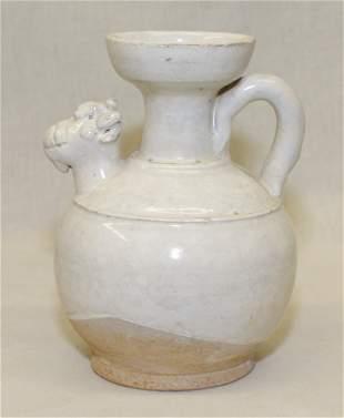 White glaze vase in shape of ewer. Song thru Ming
