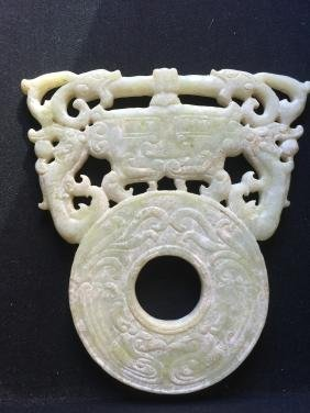 Archaic jade carved face, dragons & phoenixes.