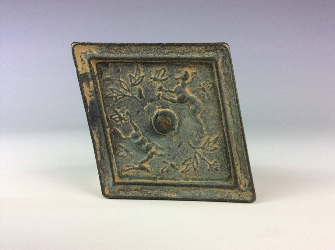 Chinese bronze mirror.