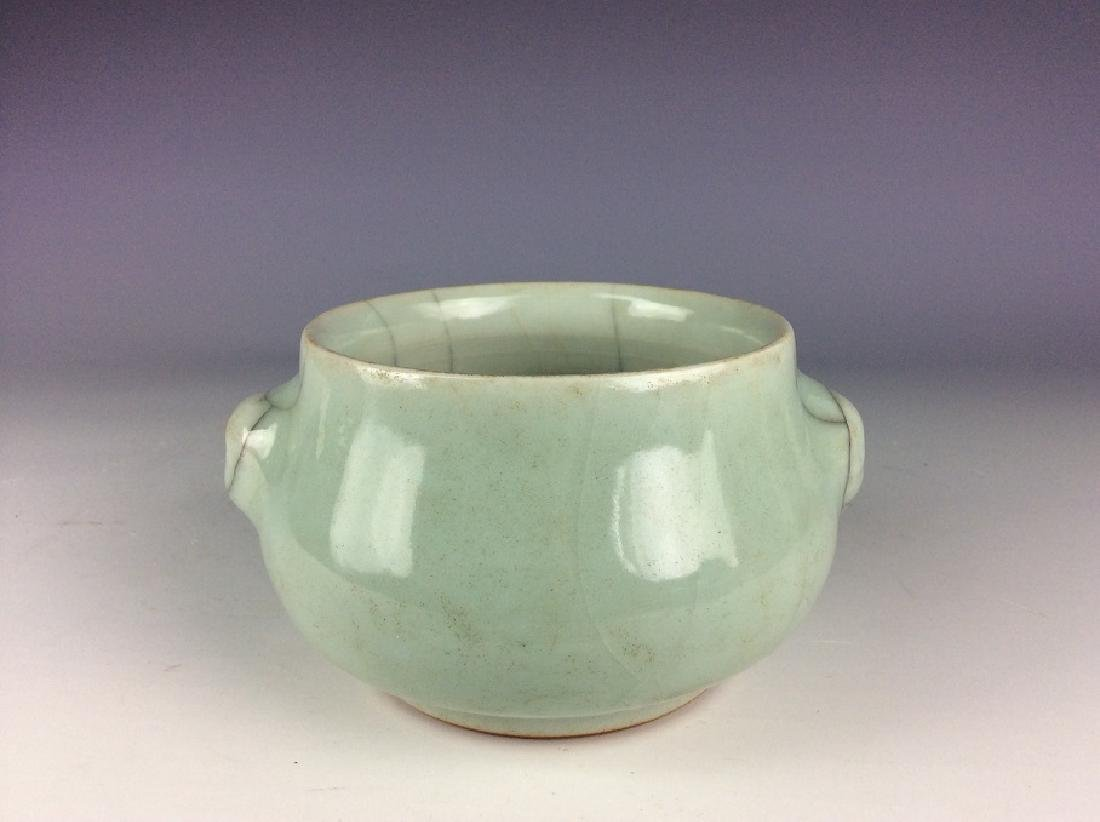 Chinese Guan style porcelain bowl, celadon glazed with