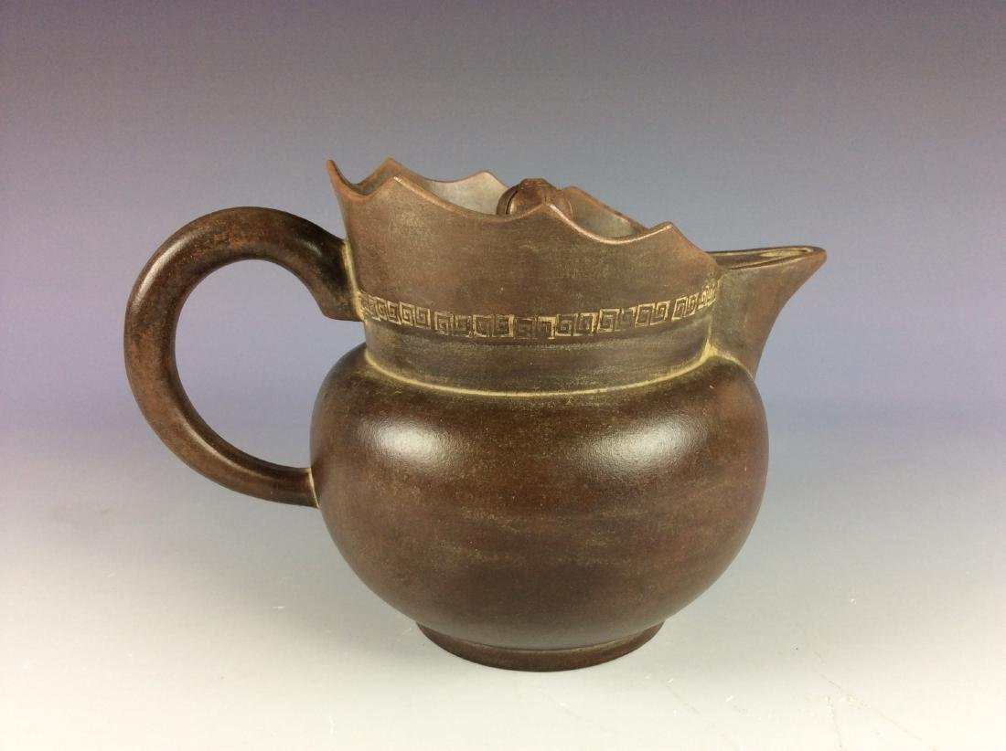Chinese Yixing clay handle teapot with mark on base.