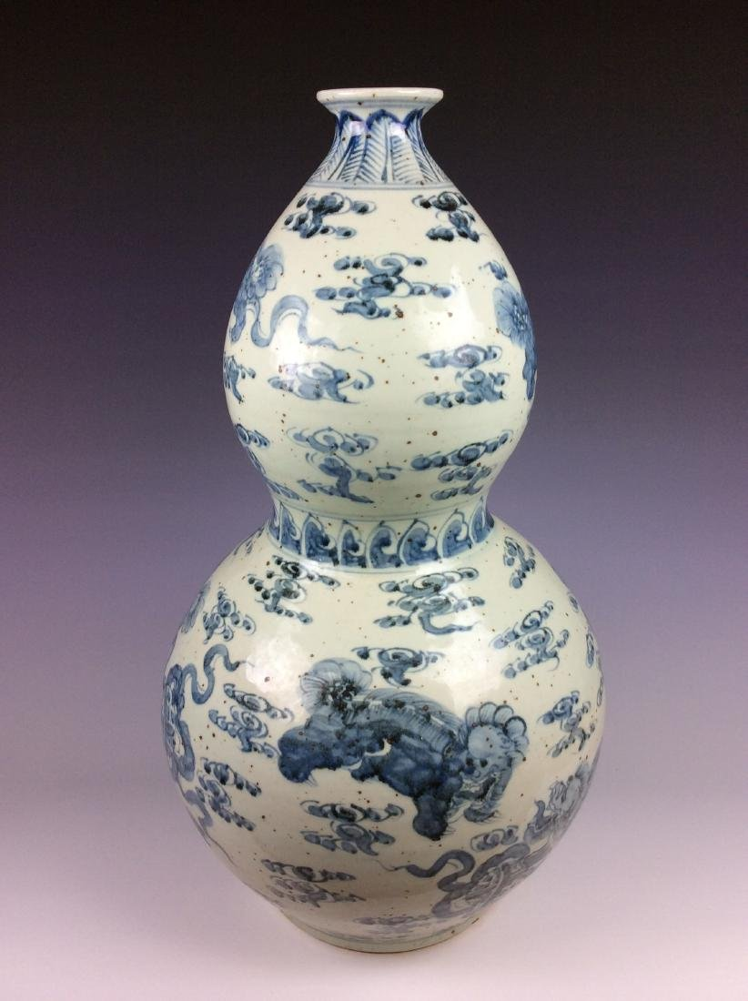 Chinese double gourd bottle vase  with lions.