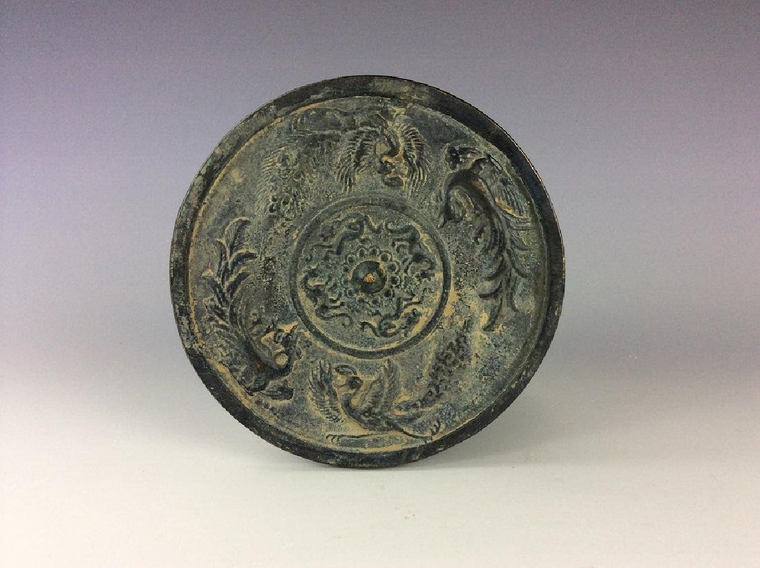 Chinese circular bronze mirror.