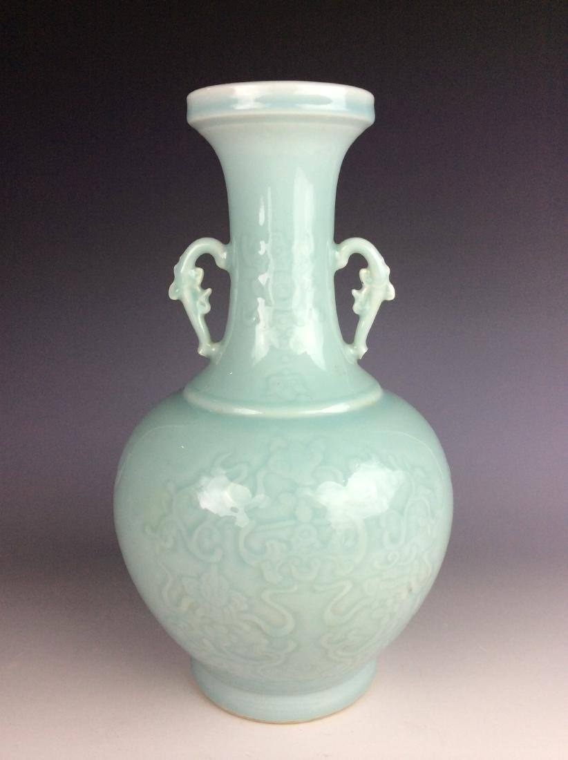 Chinese powder blue vase with bat and clouds pattern